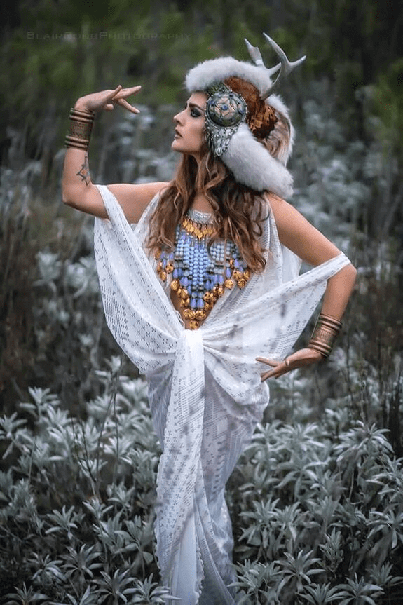 White assuit gown adorning a nature queen.