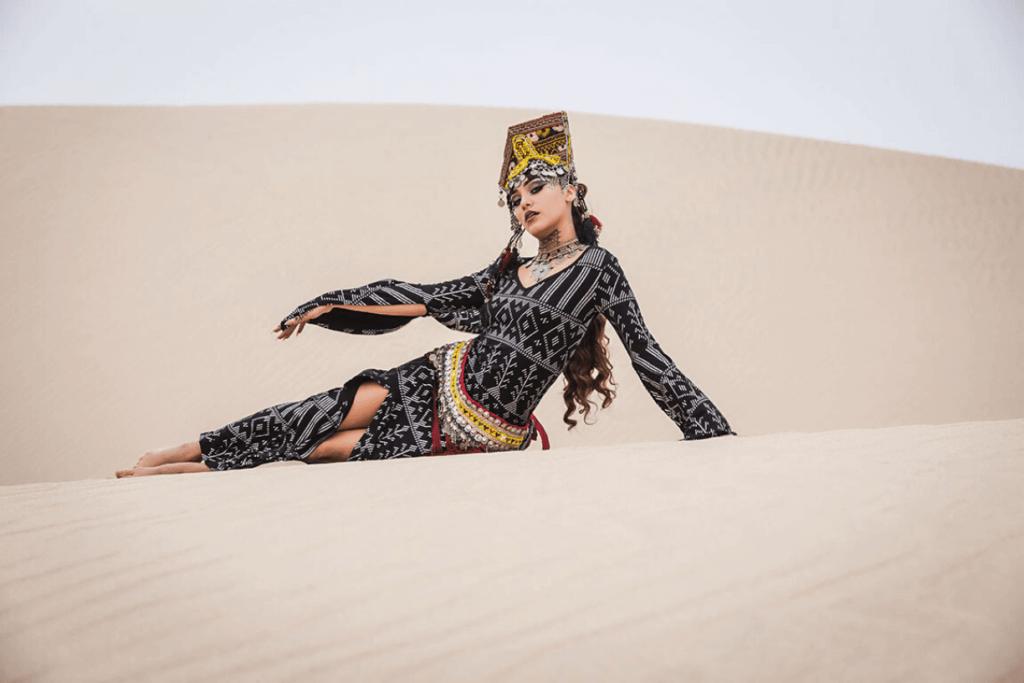 Desert queen wearing Melodia Designs faux assuit